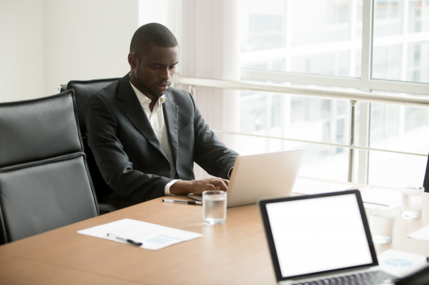 serious african businessman working laptop sitting conference table 1163 4645 - R/E Content Marketing